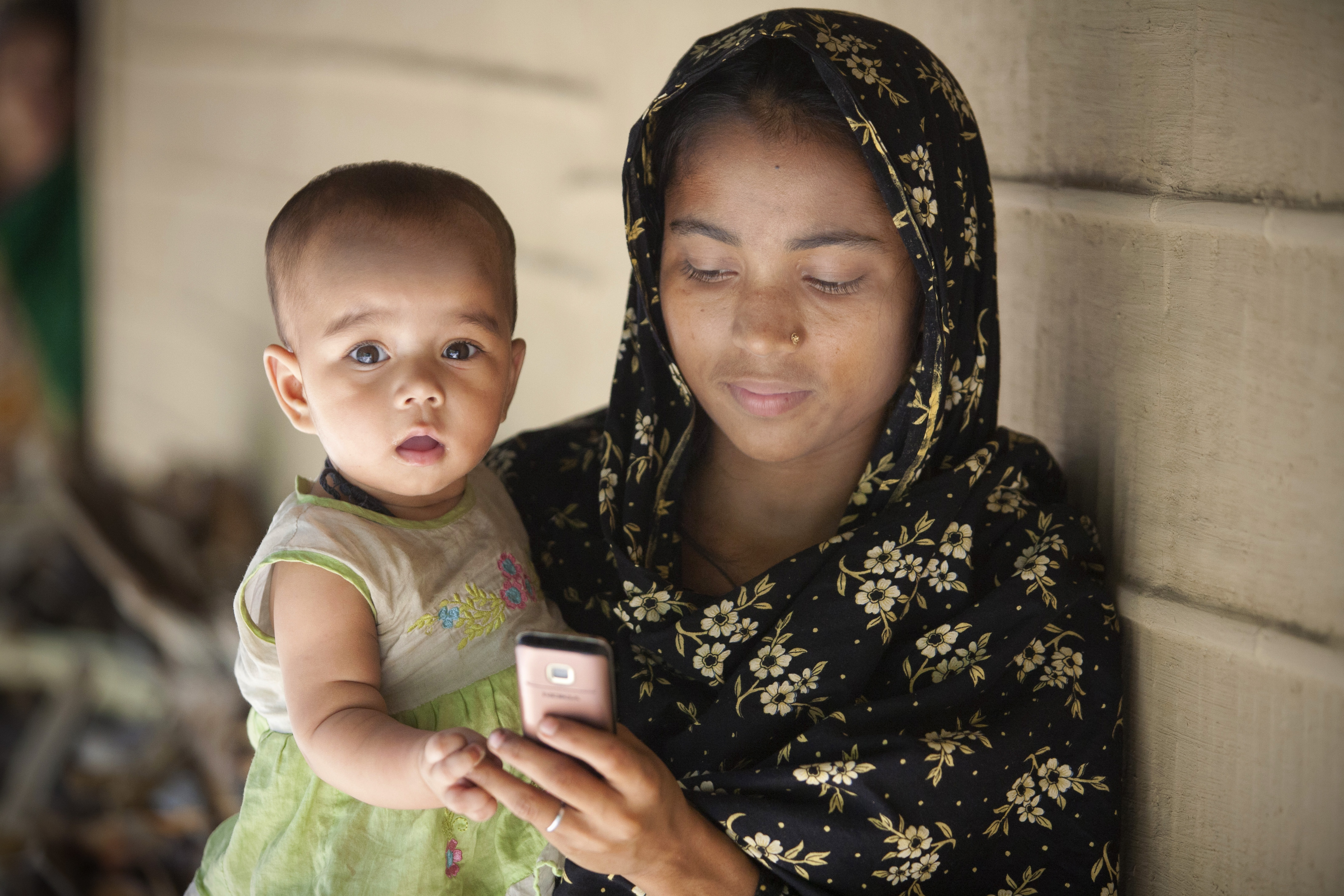 Mother and child with mobile phone.