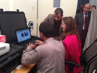 During her recent visit, USAID DAA Elisabeth Kvitashvili practices registering with Yemen's new biometric voter registration system. Photo credit: USAID