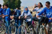 Young Palestinian Youth Local Shadow Councils install traffic signals, paint sidewalks and organize a local tourism bike tour
