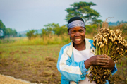 Uganda is one of the fastest growing economies in Africa. Feed the Future is helping increase opportunities for smallholder farmers like Alice Monigo in Uganda by providing trainings for women. /CNFA
