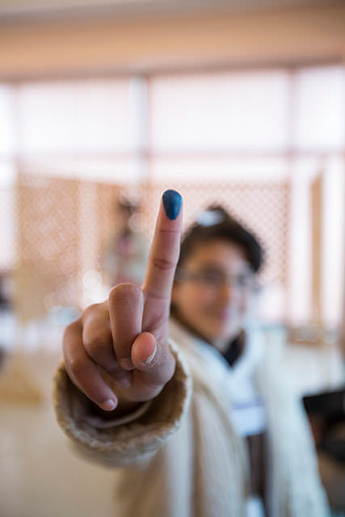 Photo of woman with ink on finger